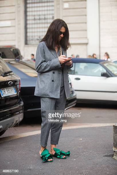 Stylist/Editor Viviana Volpicella exits Salvatore Ferragamo in wears a Dsquared2 suit and NumeroVentuno N21 shoes on Day 5 of Milan Fashion Week FW15...