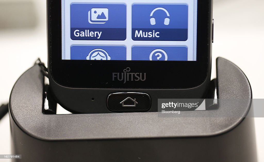 A Stylistic S01 smartphone sits in a charging dock in the Fujitsu Ltd. pavilion at the Mobile World Congress in Barcelona, Spain, on Wednesday, Feb. 27, 2013. The Mobile World Congress, where 1,500 exhibitors converge to discuss the future of wireless communication, is a global showcase for the mobile technology industry and runs from Feb. 25 through Feb. 28. Photographer: Simon Dawson/Bloomberg via Getty Images