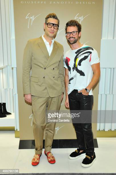 Stylists Cameron Silver and Brad Goreski attend the Giuseppe Zanotti Design Beverly Center store opening event on September 11 2014 in Los Angeles...