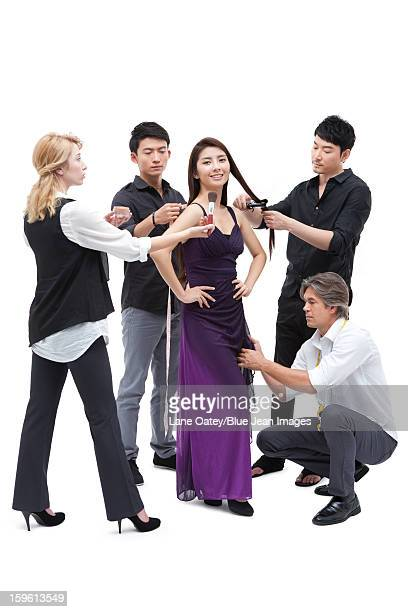 Stylists dressing the female model up