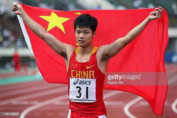 Su Bingtian of China celebrates after winning the gold medal in the Men's 100m final during the day two of the 19th Asian Athletics Championships at...