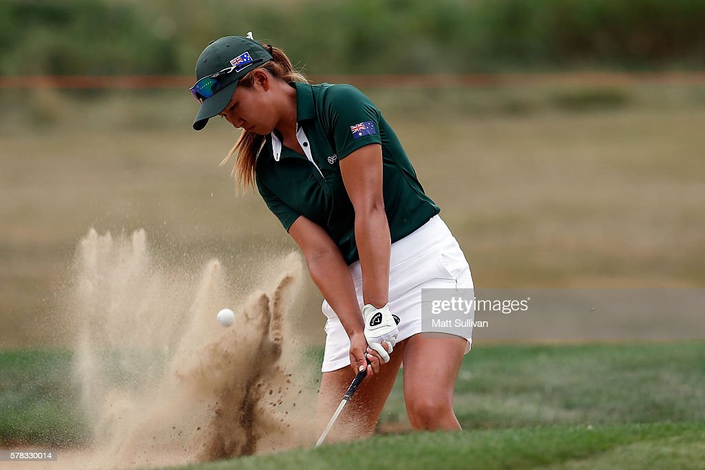 Su Oh of Australia hits from a bunker on the 14th hole during the fourball session of the 2016 UL International Crown at the Merit Club on July 21...