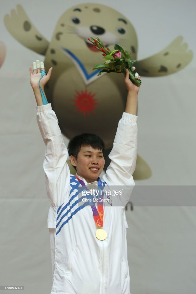 Su Shih Lin of Chinese Taipei celebrates after receiving her gold medal during the victory ceremony for the Kurash Women's -63 kg Final at Ansan Sangnoksu Gymnasium on July 6, 2013 in Incheon, South Korea.
