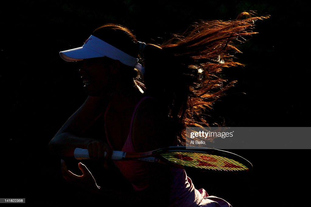 Su Wei Hsieh of Chinese Taipai playing with doubles partner Shuai Peng of China returns a shot against Maria Kirilenko of Russia and Nadia Petrova of Russia during Day 6 at Crandon Park Tennis Center at the Sony Ericsson Open on March 24, 2012 in Key Biscayne, Florida.