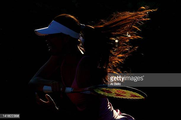 Su Wei Hsieh of Chinese Taipai playing with doubles partner Shuai Peng of China returns a shot against Maria Kirilenko of Russia and Nadia Petrova of...
