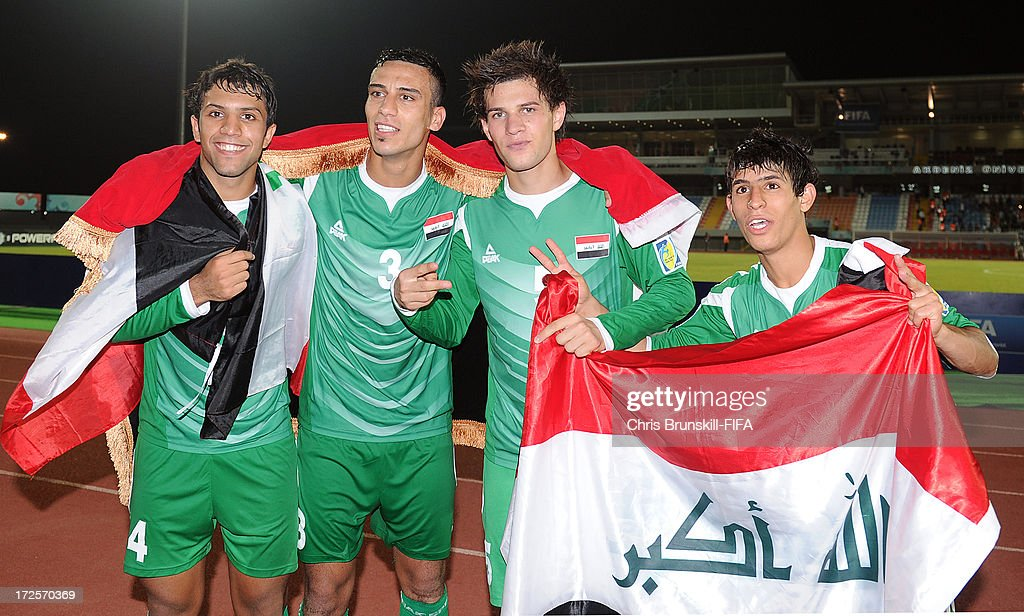 Suad Natiq, Ali Adnan, Ali Faez and Mahdi Kamil of Iraq celebrate at full-time following the FIFA U20 World Cup Round of 16 match between Iraq and Paraguay at Akdeniz University Stadium on July 03, 2013 in Antalya, Turkey.