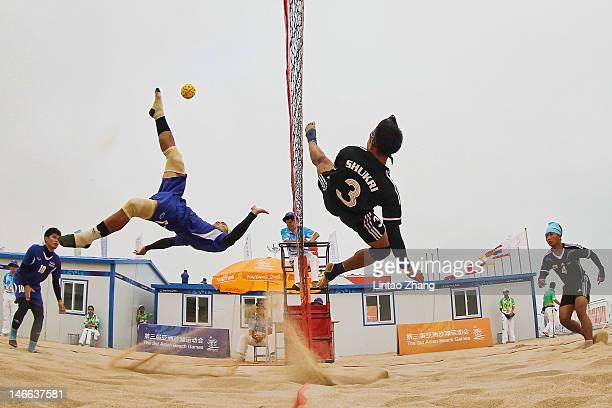 Suapimpa Komkid of Thailand kicks over the net against Mohammad Shukri Jaineh of Brunei Darussalam during the Beach Sepaktakraw Men's Regu Semifinal...