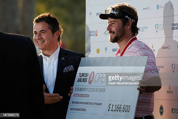 Suat Kilic of the Turkish Minister for youth and sport presents Victor Dubuisson of France with winners cheque after winning the Turkish Airlines...