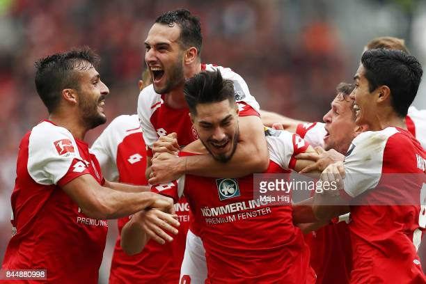 Suat Serdar of Mainz celebrates with Levin Oeztunali of Mainz team mates after he scored his teams third goal to make it 31 during the Bundesliga...