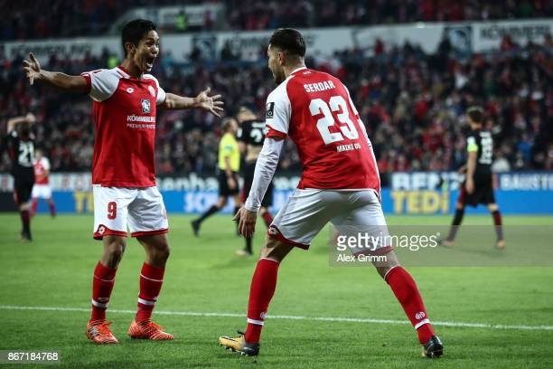 Suat Serdar of Mainz celebrates with Yoshinori Muto after scoring the equalizing goal to make it 11 during the Bundesliga match between 1 FSV Mainz...