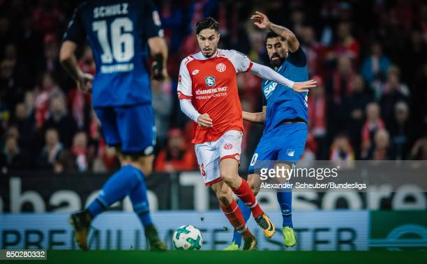 Suat Serdar of Mainz in action against Kerem Demirbay of Hoffenheim during to the Bundesliga match between 1 FSV Mainz 05 and TSG 1899 Hoffenheim at...