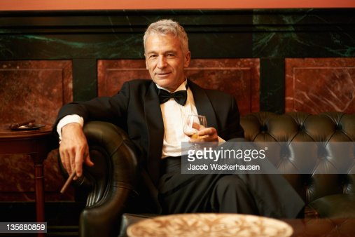 Suave man in a cigar lounge