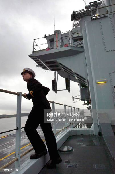 Sub Lieutenant Ben Graham on board the deck of the HMS Ark Royal as the ship is prepared at Rosyth dockyard ahead of its sea trials