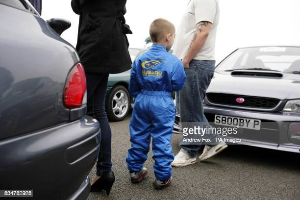 Subaru fan James Pemberton from Birmingham wearing his Subaru rally driver's suit as an estimated 1300 Subaru car owners make their way to the...