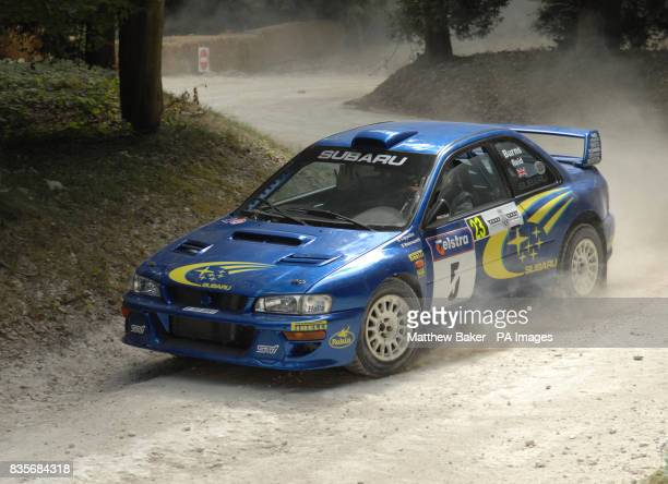 A Subaru Impreza WRC is driven around the Forest Rally Stage during the 2009 Goodwood Festival of Speed