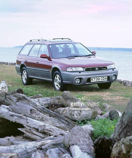 Subaru Legacy Outback on beach 2000