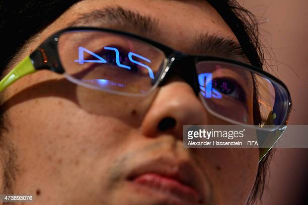 Subaru Sagano of Japan plays at the PS4 during the group stage of the finale for FIFA Interactive World Cup 2015 at Palais am Lenbachplatz on May 18...