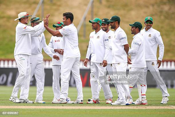 Subashis Roy of Bangladesh celebrates with teammates after taking his first test wicket to dismiss Colin de Grandhomme of New Zealand during day four...