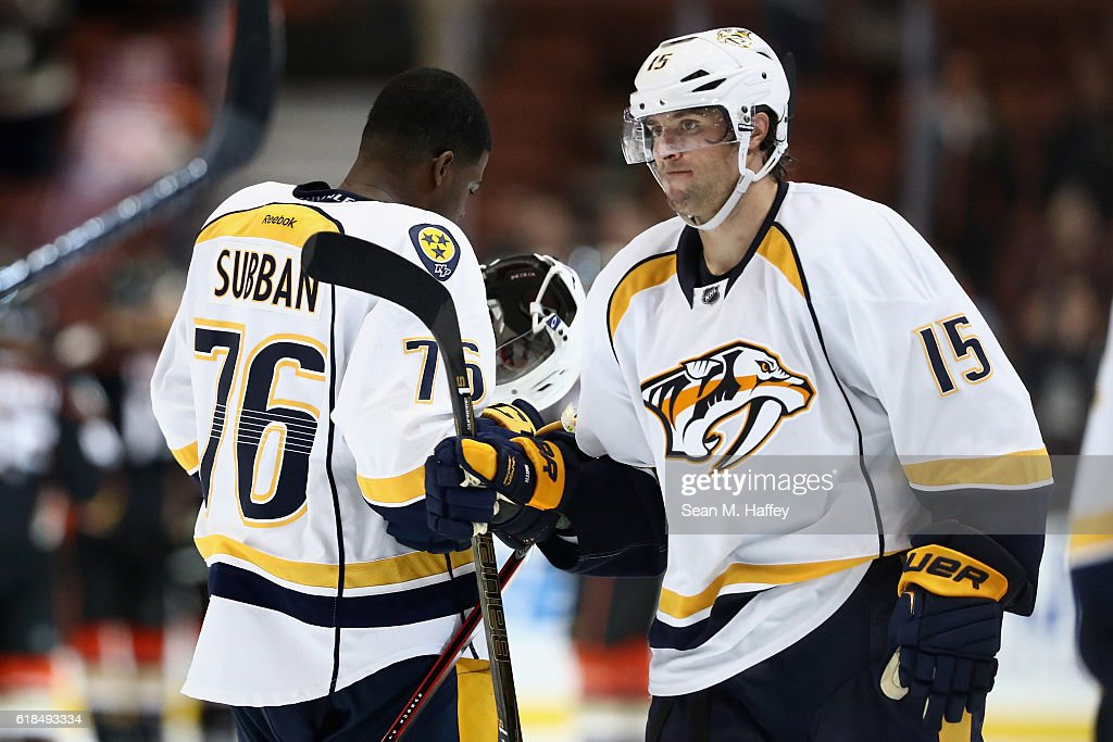 P.K. Subban #76 and Craig Smith #15 of the Nashville Predators look on after being defeated by the Anaheim Ducks 6-1 in a game at Honda Center on October 26, 2016 in Anaheim, California.