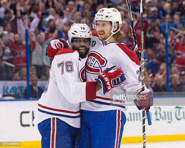 PK Subban and Jeff Petry of the Montreal Canadiens celebrate a goal against the Tampa Bay Lightning during the second period in Game Four of the...