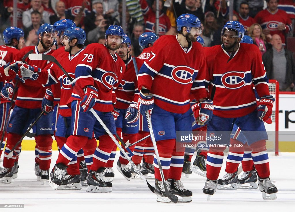 <a gi-track='captionPersonalityLinkClicked' href=/galleries/search?phrase=P.K.+Subban&family=editorial&specificpeople=714418 ng-click='$event.stopPropagation()'>P.K. Subban</a> #76 and <a gi-track='captionPersonalityLinkClicked' href=/galleries/search?phrase=Max+Pacioretty&family=editorial&specificpeople=4324972 ng-click='$event.stopPropagation()'>Max Pacioretty</a> #67 of the Montreal Canadiens celebrates after defeating the New York Rangers during Game Five of the Eastern Conference Final in the 2014 NHL Stanley Cup Playoffs at Bell Centre on May 27, 2014 in Montreal, Canada. Canadiens defeated the Rangers 7-4.