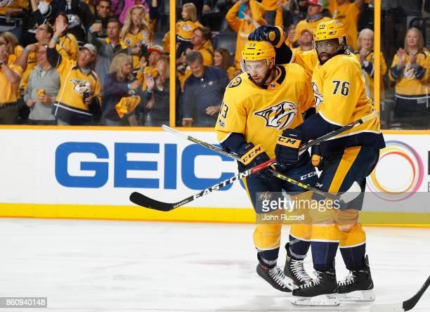 K Subban and Nick Bonino of the Nashville Predators celebrate a goal against the Philadelphia Flyers during an NHL game at Bridgestone Arena on...