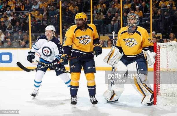 K Subban and Pekka Rinne of the Nashville Predators skate against Mark Scheifele of the Winnipeg Jets during an NHL game at Bridgestone Arena on...