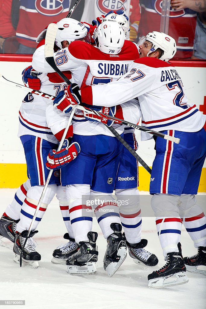 PK Subban #76 and teammates of the Montreal Canadiens celebrate a goal against the Calgary Flames at Scotiabank Saddledome on October 9, 2013 in Calgary, Alberta, Canada.
