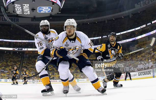 K Subban and Viktor Arvidsson of the Nashville Predators skate towards the net in front of Chris Kunitz of the Pittsburgh Penguins during the first...