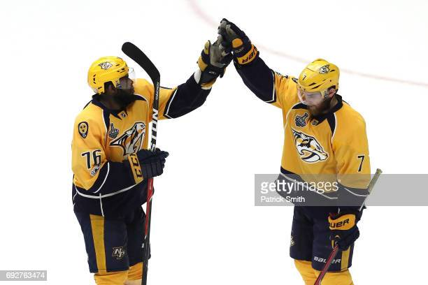 K Subban and Yannick Weber of the Nashville Predators celebrate defeating the Pittsburgh Penguins with a score of 4 to 1 in Game Four of the 2017 NHL...