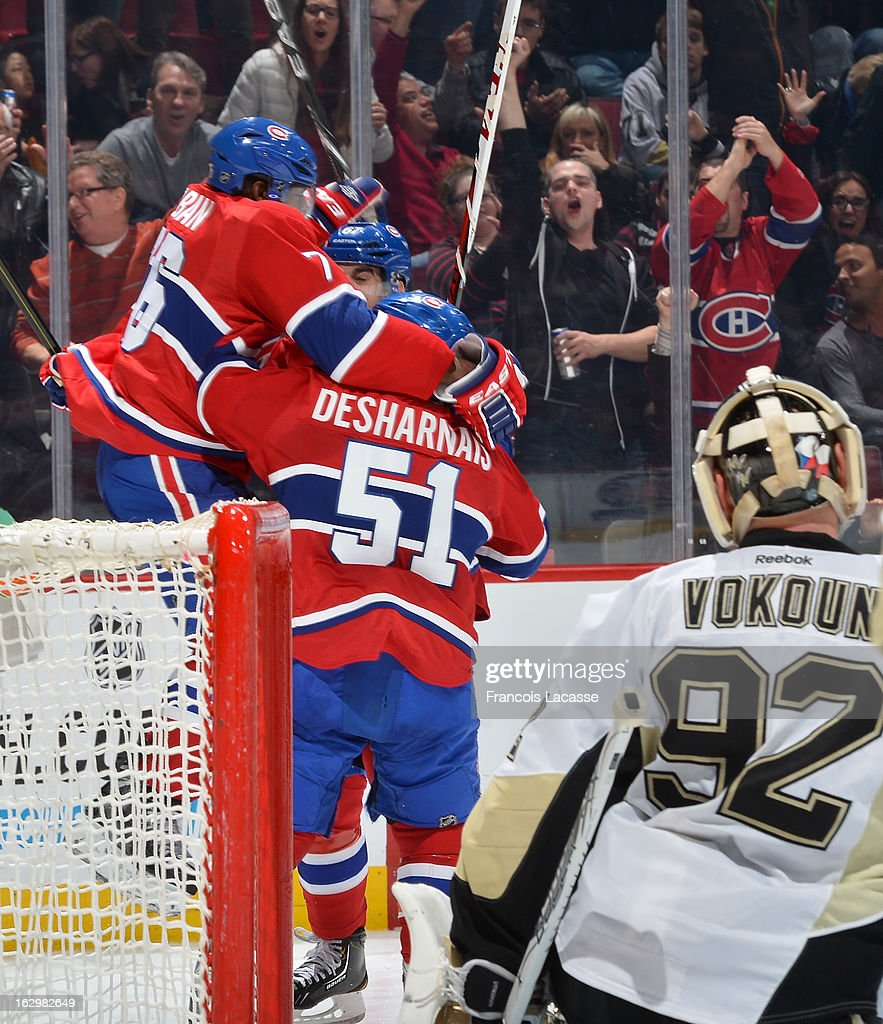 P.K. Subban #76 (L) celebrates his late second period goal with teammate David Desharnais #51 of the Montreal Canadiens as goalie Tomas Vokoun #92 of the Pittsburgh Penguins looks on during the NHL game on March 2, 2013 at the Bell Centre in Montreal, Quebec, Canada.