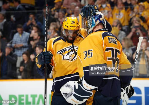 K Subban congratulates Pekka Rinne of the Nashville Predators on a 31 win against the Calgary Flames during an NHL game at Bridgestone Arena on March...