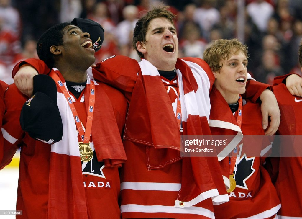 K Subban John Tavares and Tyler Ennis all of Team Canada stand arm in arm as they sing the Canadian National Anthem after defeating Team Sweden...