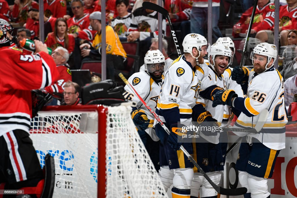P.K. Subban #76, Mattias Ekholm #14, Mike Fisher #12 and Harry Zolnierczyk #26 of the Nashville Predators celebrate after Zolnierczyk scored against the Chicago Blackhawks in the second period in Game Two of the Western Conference First Round during the 2017 NHL Stanley Cup Playoffs at the United Center on April 15, 2017 in Chicago, Illinois.