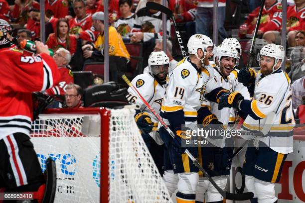 PK Subban Mattias Ekholm Mike Fisher and Harry Zolnierczyk of the Nashville Predators celebrate after Zolnierczyk scored against the Chicago...