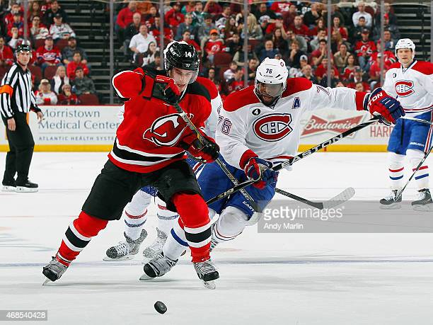 K Subban of the Montreal Canadiens and Adam Henrique of the New Jersey Devils battle for position during the game at the Prudential Center on April 3...