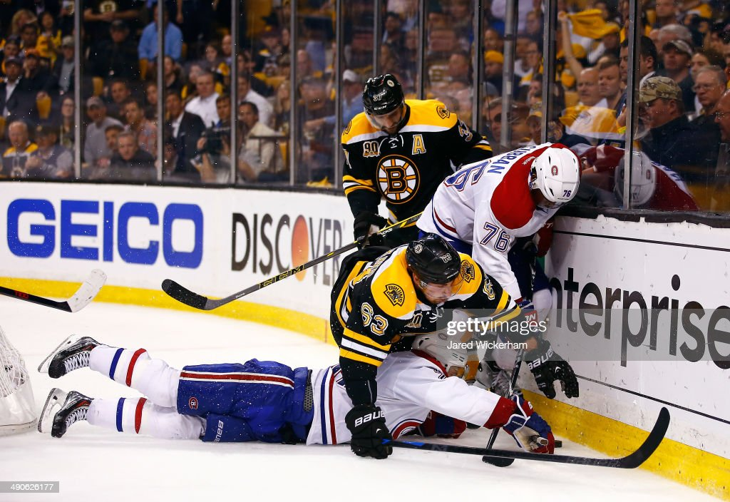 P.K. Subban #76 of the Montreal Canadiens and Brad Marchand #63 of the Boston Bruins battle for a puck behind the net during Game Seven of the Second Round of the 2014 NHL Stanley Cup Playoffs at the TD Garden on May 14, 2014 in Boston, Massachusetts.