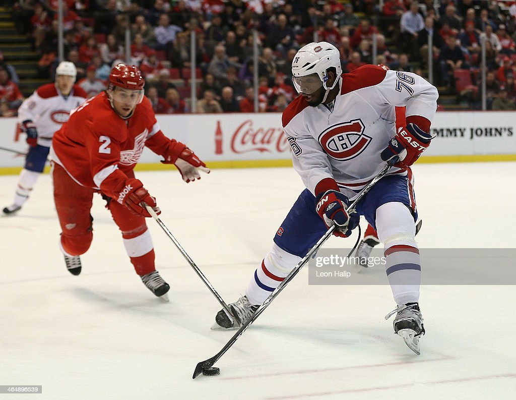 P. K. Subban #76 of the Montreal Canadiens and Brendan Smith #2 of the Detroit Red Wings battle for puck control during the third period of the game at Joe Louis Arena on January 24, 2014 in Detroit, Michigan. The Wings defeated the Canadiens 4-1.