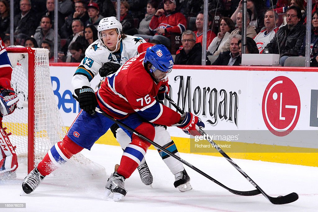 <a gi-track='captionPersonalityLinkClicked' href=/galleries/search?phrase=P.K.+Subban&family=editorial&specificpeople=714418 ng-click='$event.stopPropagation()'>P.K. Subban</a> #76 of the Montreal Canadiens and John McCarthy #43 of the San Jose Sharks battle for the puck during the NHL game at the Bell Centre on October 26, 2013 in Montreal, Quebec, Canada. The Sharks defeated the Canadiens 2-0.