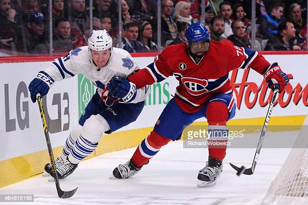 K Subban of the Montreal Canadiens and Morgan Rielly of the Toronto Maple Leafs chase the puck during the NHL game at the Bell Centre on January 17...