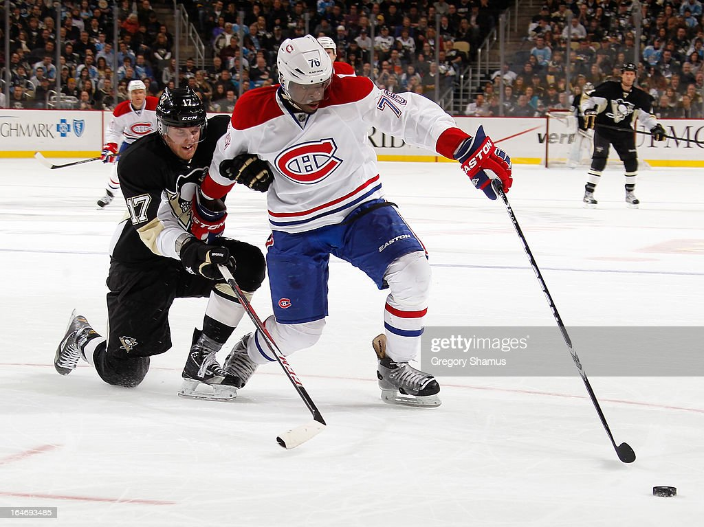 P.K. Subban #76 of the Montreal Canadiens battles for the loose puck against Dustin Jeffrey #17 of the Pittsburgh Penguins on March 26, 2013 at Consol Energy Center in Pittsburgh, Pennsylvania.