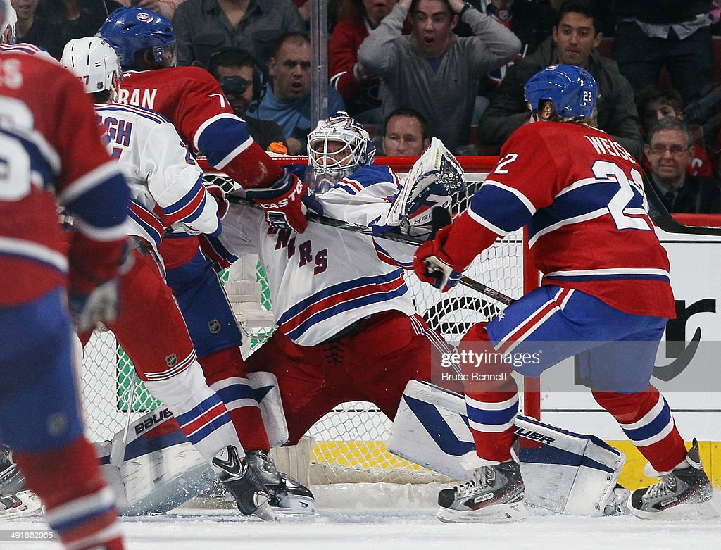 <a gi-track='captionPersonalityLinkClicked' href=/galleries/search?phrase=P.K.+Subban&family=editorial&specificpeople=714418 ng-click='$event.stopPropagation()'>P.K. Subban</a> #76 of the Montreal Canadiens bumps into <a gi-track='captionPersonalityLinkClicked' href=/galleries/search?phrase=Henrik+Lundqvist&family=editorial&specificpeople=217958 ng-click='$event.stopPropagation()'>Henrik Lundqvist</a> #30 of the New York Rangers in Game One of the Eastern Conference Final during the 2014 Stanley Cup Playoffs at the Bell Centre on May 17, 2014 in Montreal, Canada. The Rangers defeated the Canadiens 7-2.