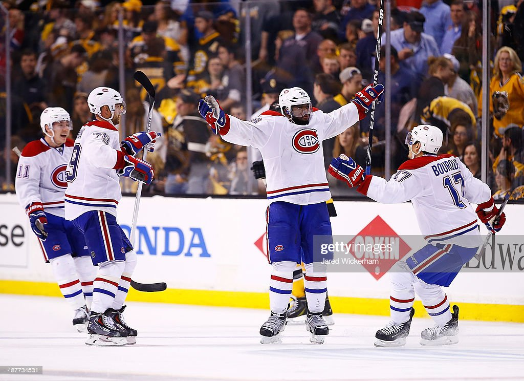 <a gi-track='captionPersonalityLinkClicked' href=/galleries/search?phrase=P.K.+Subban&family=editorial&specificpeople=714418 ng-click='$event.stopPropagation()'>P.K. Subban</a> #76 of the Montreal Canadiens celebrates his game-winning power play goal with his teammates in the second overtime period against the Boston Bruins in Game One of the Second Round of the 2014 NHL Stanley Cup Playoffs on May 1, 2014 in Boston, Massachusetts.