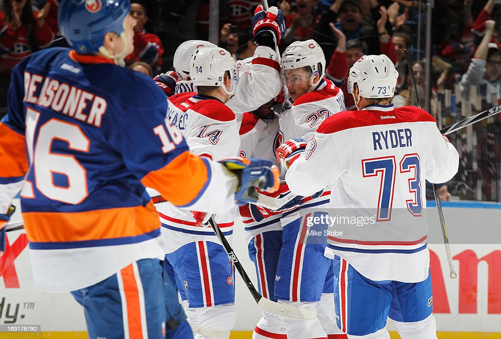 P.K. Subban #76 of the Montreal Canadiens celebrates his second period goal with his teammates against the New York Islanders at Nassau Veterans Memorial Coliseum on March 5, 2013 in Uniondale, New York. The Islanders defeated the Canadiens 6-3.