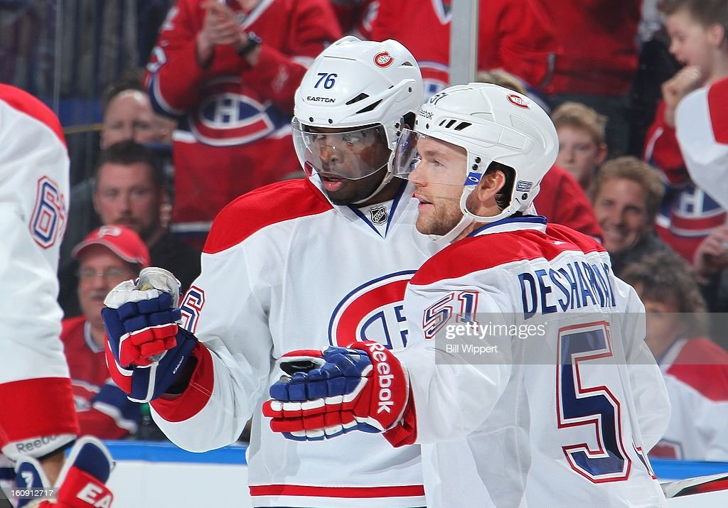 <a gi-track='captionPersonalityLinkClicked' href=/galleries/search?phrase=P.K.+Subban&family=editorial&specificpeople=714418 ng-click='$event.stopPropagation()'>P.K. Subban</a> #76 of the Montreal Canadiens celebrates his second-period goal against the Buffalo Sabres with teammate <a gi-track='captionPersonalityLinkClicked' href=/galleries/search?phrase=David+Desharnais&family=editorial&specificpeople=4084305 ng-click='$event.stopPropagation()'>David Desharnais</a> #51 on February 7, 2013 at the First Niagara Center in Buffalo, New York.