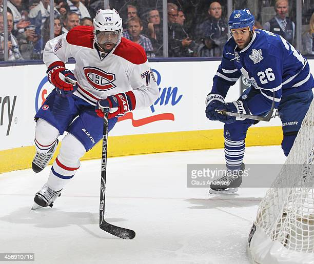 K Subban of the Montreal Canadiens chases after a loose puck ahead of Daniel Winnik of the Toronto Maple Leafs in the NHL season opener at the Air...