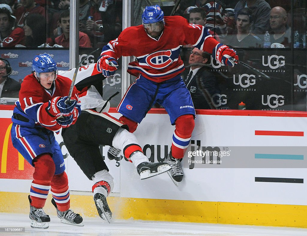 P.K. Subban #76 of the Montreal Canadiens collides with a member of the Ottawa Senators in Game One of the Eastern Conference Quarterfinals during the 2013 NHL Stanley Cup Playoffs at the Bell Centre on May 2, 2013 in Montreal, Quebec, Canada.