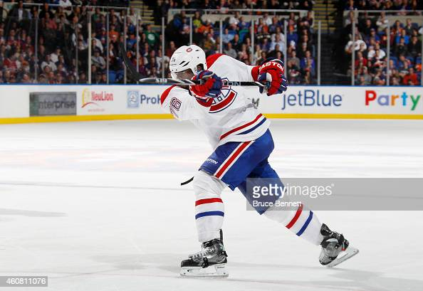 K Subban of the Montreal Canadiens controls the puck against the New York Islanders in the third period at Nassau Veterans Memorial Coliseum on...