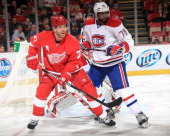 K Subban of the Montreal Canadiens defends against Daniel Cleary of the Detroit Red Wings to the side of the net during an NHL game on January 24...