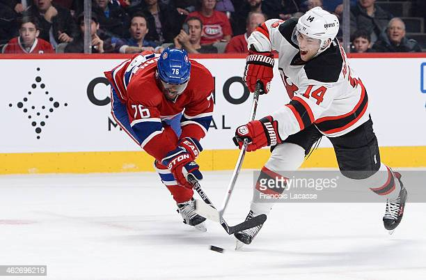 K Subban of the Montreal Canadiens fights for the puck against Adam Henrique of the New Jersey Devils during the NHL game on January 14 2014 at the...
